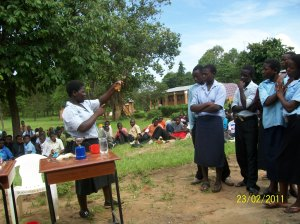Students demonstrating an experiment